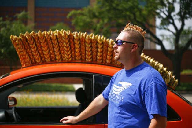 Eric Davenport sports the same haircut as his Volkswagen Beetle. Photo: Michael Paulsen, Houston Chronicle / HC
