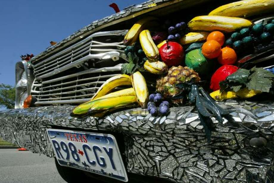 """Detail of """"The Fruitmobile"""" by Jackie Harris, one of the cars in that first 1986 parade. It's now owned by the Orange Show. Photo: Jessica Kourkounis, For The Chronicle"""