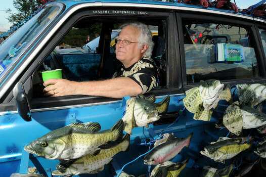 "David Shine sits in his car ""The Sashimi Tabernacle Choir"" which is covered with robotic singing fish. Photo: Dave Rossman, For The Chronicle"