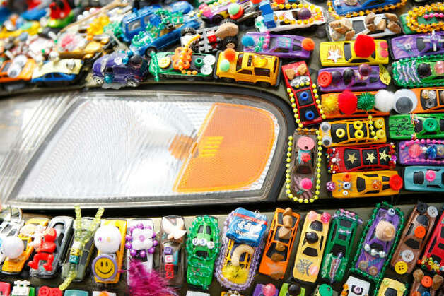 Poe Elementary School named their creation 'Art Car Art Car,' which is covered in miniature toy cars. Photo: Nick De La Torre, Houston Chronicle / HC