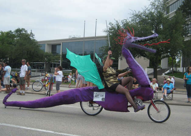 It's not really a car but this art bike is a dragon on two wheels. Photo: Roberta Macinnis, Houston Chronicle / HC
