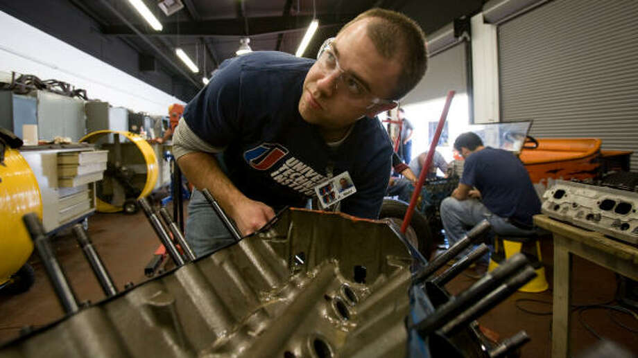 Jason Mahl helps to tear down a V-8 engine during a class at Universal Technical Institute. Enrollment is up at technical school such as UTI at 721 Lockhaven. Photo: Steve Campbell, Chronicle