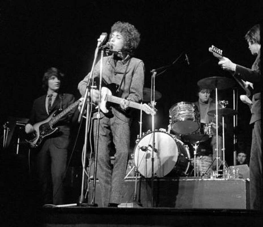 Dylan with the Band (Houstonian Mickey Jones sitting in on drums for Levon Helm) on the controversial 1966 acoustic/electric tour. Photo: MARK MAKIN, AP