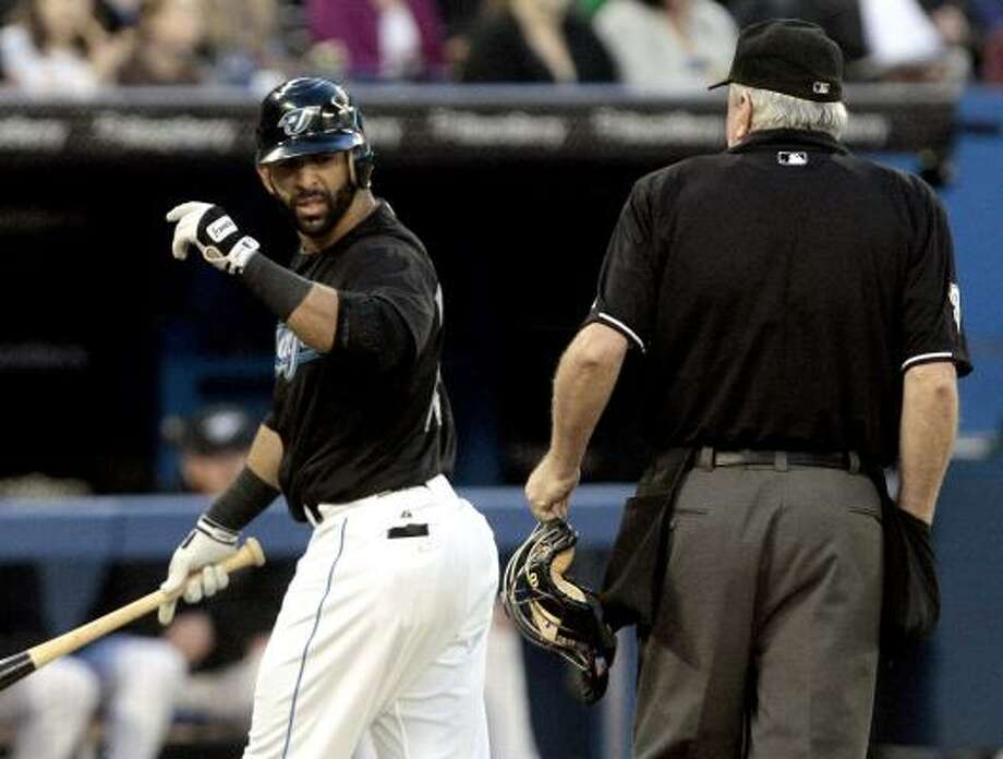 Toronto's Jose Bautista argues a strike call with home plate umpire Brian Gorman. Photo: Abelimages, Getty