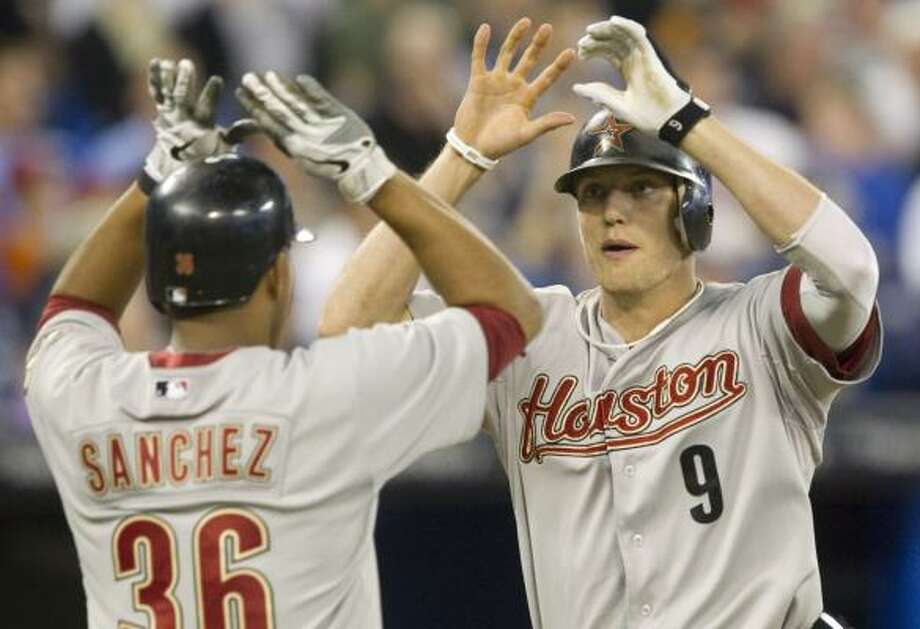 May 22: Astros 3, Blue Jays 2Astros right fielder Hunter Pence reaches home after driving in second baseman Angel Sanchez with a two-run home run. Photo: Darren Calabrese, Associated Press