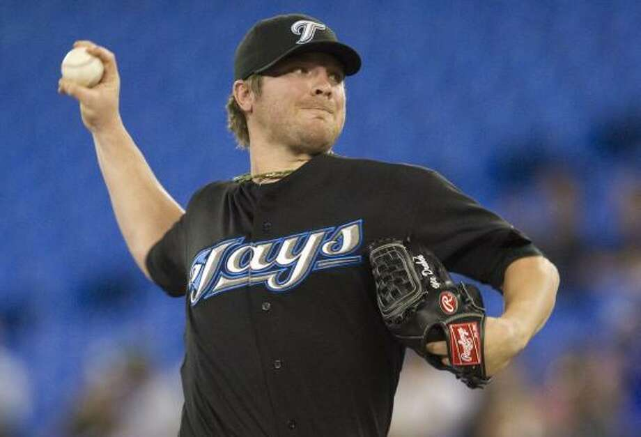 Blue Jays pitcher Kyle Drabek made his first start against the former team of his dad, Doug. Photo: Darren Calabrese, Associated Press