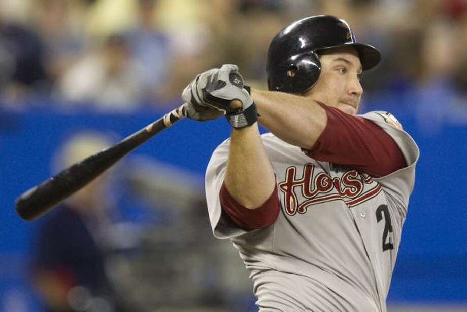 Astros first baseman Brett Wallace hits an RBI single during the third inning. Photo: Darren Calabrese, Associated Press