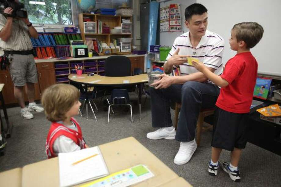 Yao Ming answers a question from his host, Jackson Loyd. Photo: Mayra Beltran, Houston Chronicle