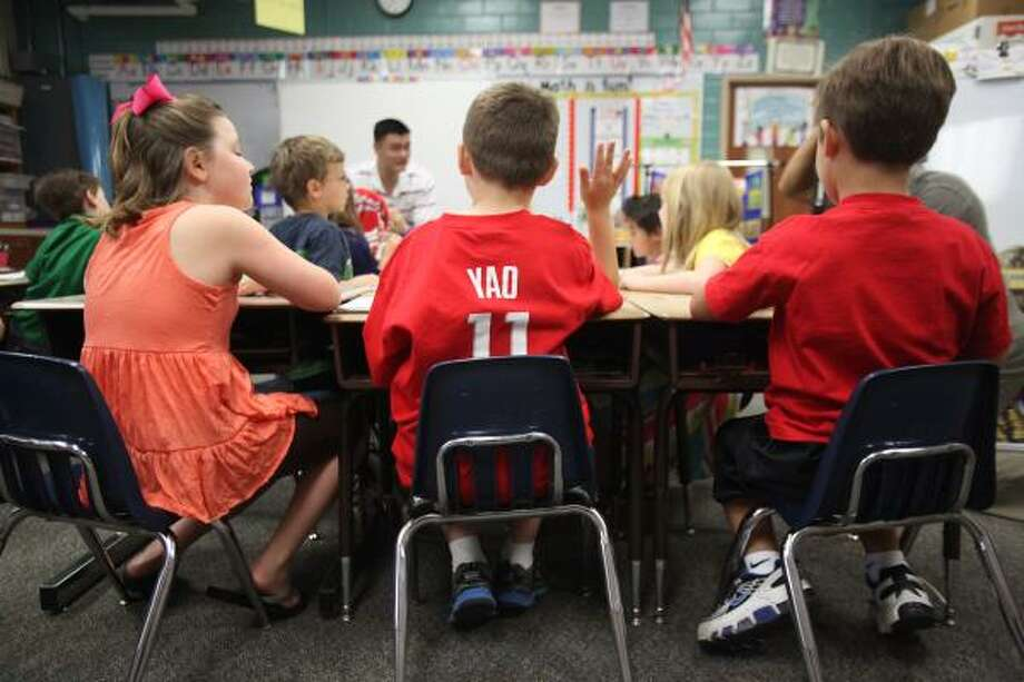 From left, Kendall Bowe, Nicholas Lanzagorta, Jackson Loyd listen to Yao answer their questions. Photo: Mayra Beltran, Houston Chronicle