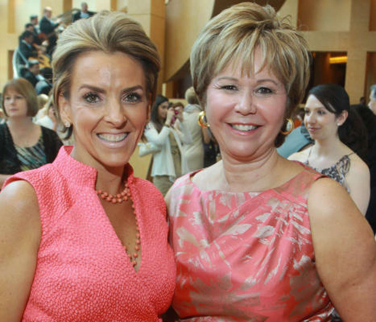 Mary Tere Perusquia, president of the Latin Women's Initiative, and Cyndy Garza Roberts, the luncheon chair.