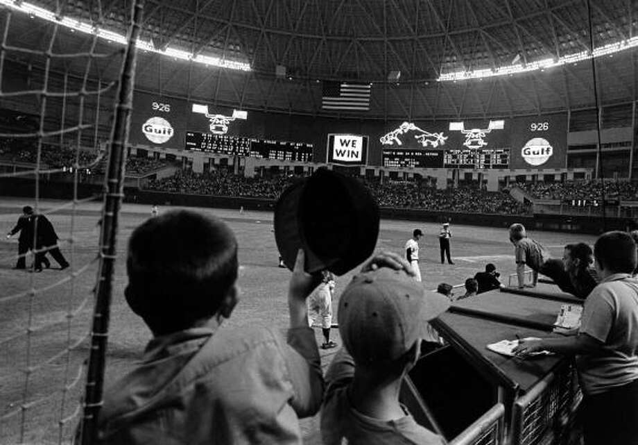 "1962-1976 Roy Hofheinz, R.E. ""Bob"" Smith (1962-65) and partners Highlights: Debut season of 1962, move to Astrodome (pictured) in 1965. Photo: Chronicle"