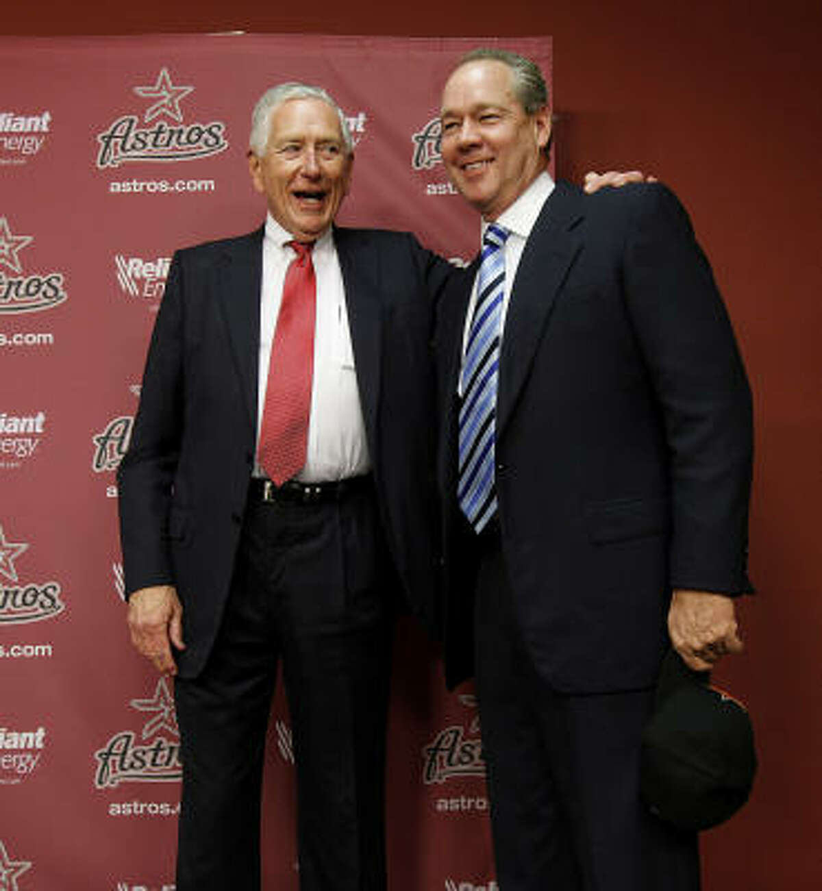 Astros owner Drayton McLane and Jim Crane take a photo together after McLane announced the purchase agreement with a group headed by Houstonian Jim Crane,Monday, May 16, 2011, in Houston.The sale of the ball club will be finalized once it is approved by Major League Baseball.