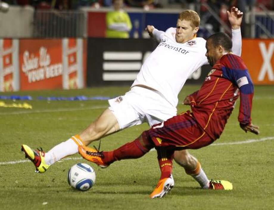 May 14: Dynamo 0, Real Salt Lake 0Real Salt Lake's Robbie Russell, right, takes a shot on goal past Dynamo defender Andrew Hainault during Saturday's match at Rio Tinto Stadium in Sandy, Utah. Photo: George Frey, Getty