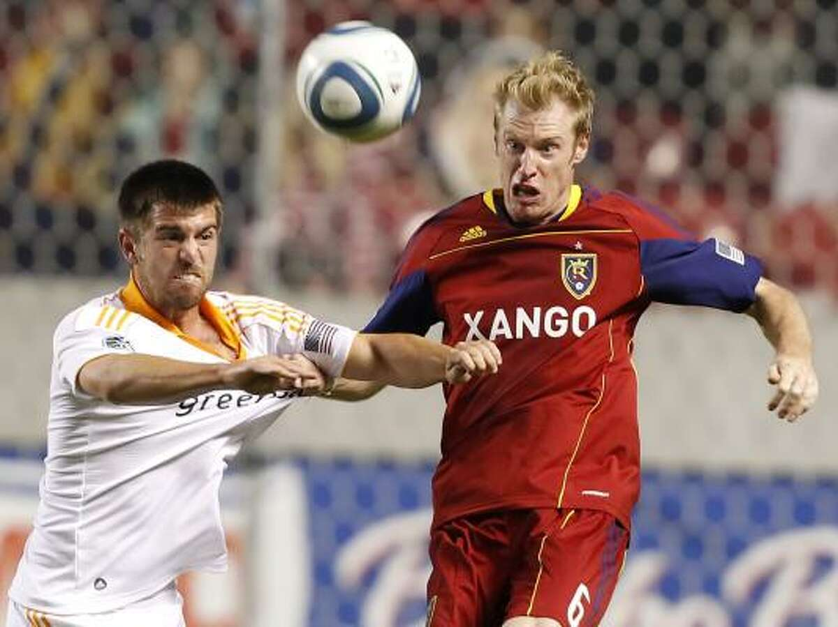 Real Salt Lake's Nat Borchers, right, and Dynamo forward Jason Garey fight for the ball during the second half.