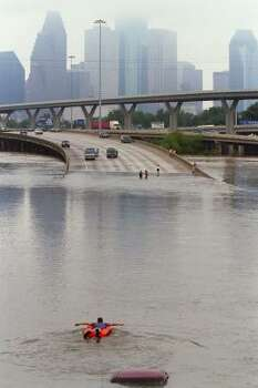 In 2001, Tropical Storm Allison devestated Southeast Texas, including the Houston area. Seen here, a man in a rubber boat paddles through flood waters caused by remnants of the storm along I-45 North of Downtown Houston. Photo: Buster Dean, Houston Chronicle