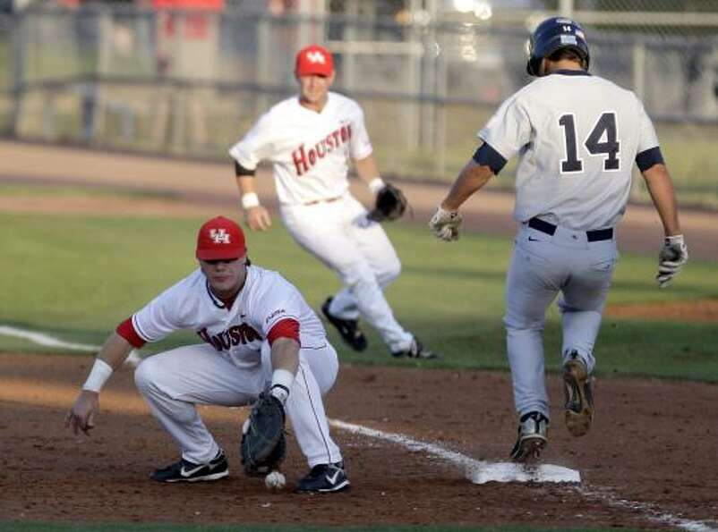 UH first baseman M.P. Cokinos, left, can't hold onto the ball while Rice's J.T Chargois reaches firs