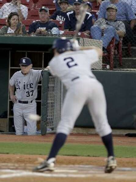 Rice coach Wayne Graham watches Shane Hoelscher avoid a pitch.