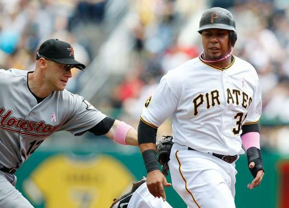 Astros second baseman Clint Barmes catches Pirates left fielder Jose Tabata in a rundown. Photo: Jared Wickerham, Getty