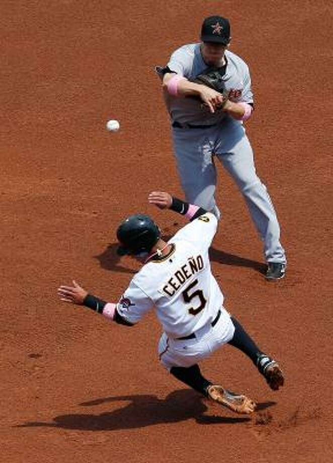 Astros second baseman Clint Barmes throws over Pirates shortstop Ronny Cedeno in an attempt to turn a double play. Photo: Jared Wickerham, Getty