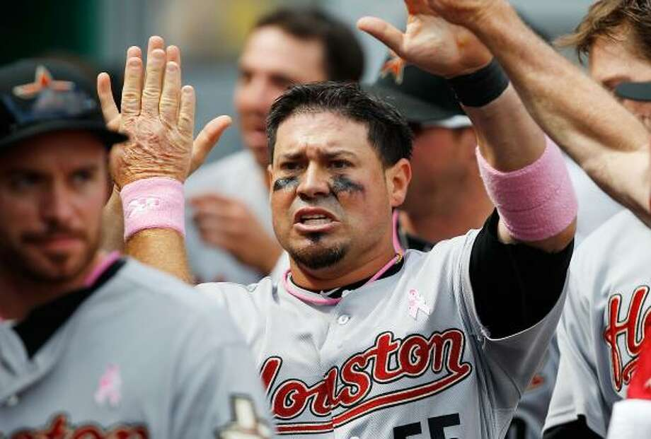 Astros catcher Humberto Quintero returns to the dugout after scoring against the Pirates. Photo: Jared Wickerham, Getty