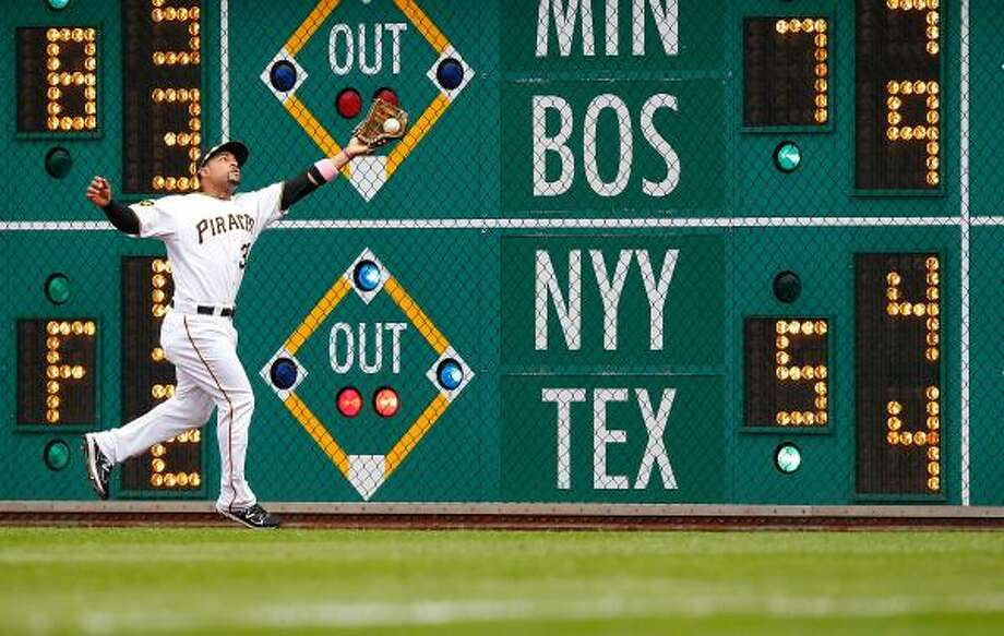 Pirates right fielder Xavier Paul catches a fly ball on the warning track. Photo: Jared Wickerham, Getty