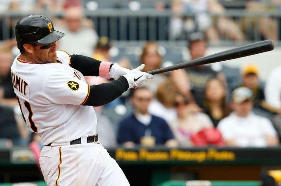 Pirates catcher Ryan Doumit connects on a three-run homer off Astros reliever Fernando Abad. Photo: Jared Wickerham, Getty