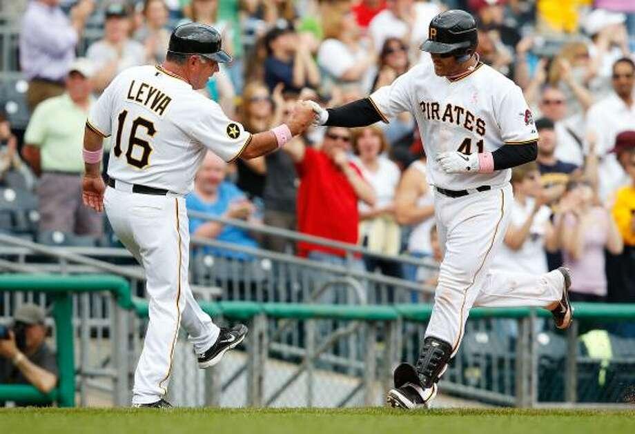 Pirates catcher Ryan Doumit rounds third base after his homer. Photo: Jared Wickerham, Getty