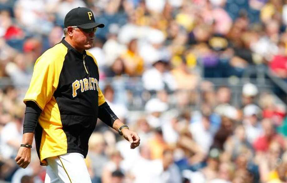 Pirates manager Clint Hurdle walks out to the mound to make a pitching change. Photo: Jared Wickerham, Getty