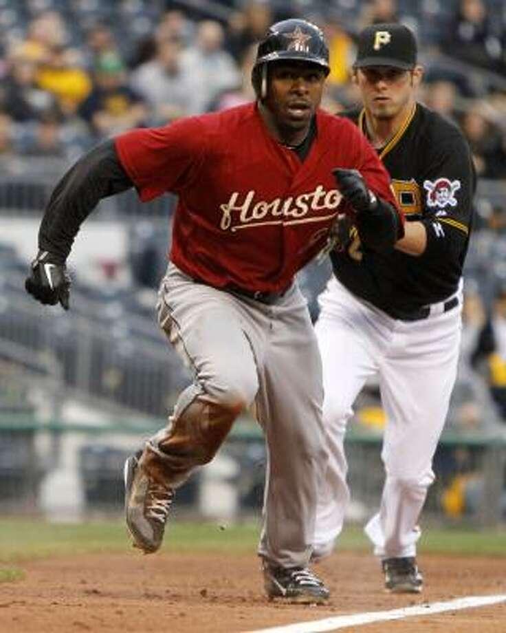 Pirates third baseman Brandon Wood, right, catches Michael Bourn in a rundown between third and home. Photo: Gene J. Puskar, Associated Press