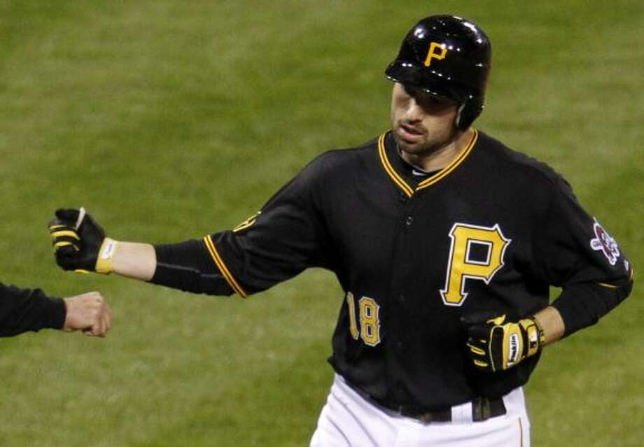 Pittsburgh's Neil Walker rounds third base after hitting a solo home run off Wandy Rodriguez in the seventh inning. Photo: Gene J. Puskar, Associated Press