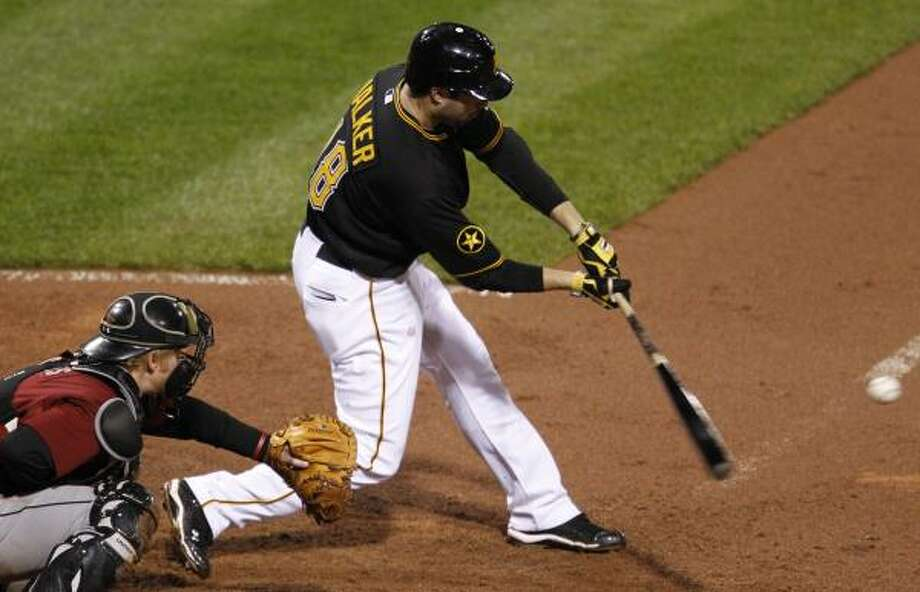 Pittsburgh's Neil Walker hits a solo home run off Wandy Rodriguez in the seventh inning. Photo: Gene J. Puskar, Associated Press