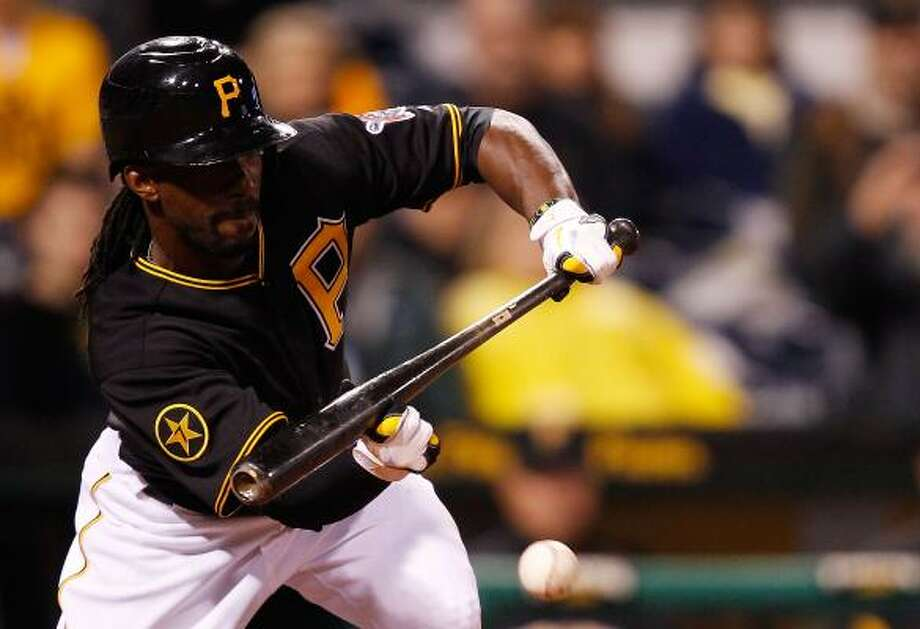 Pittsburgh's Andrew McCutchen lays down a bunt. Photo: Jared Wickerham, Getty