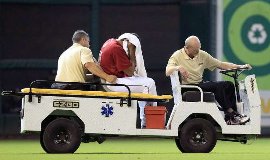 May 1: Astros 5, Brewers0  Astros left fielder Carlos Lee rides off the field after colliding with Angel Sanchez in the seventh inning. Lee went to a hospital for X-rays. Photo: Cody Duty, Chronicle