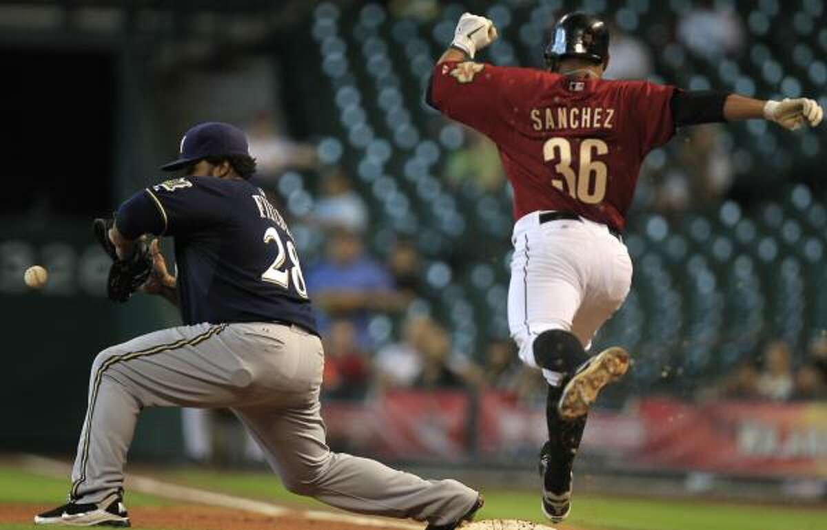 Astros shortstop Angel Sanchez fails to reach first ahead of the throw to Brewers first baseman Prince Fielder.