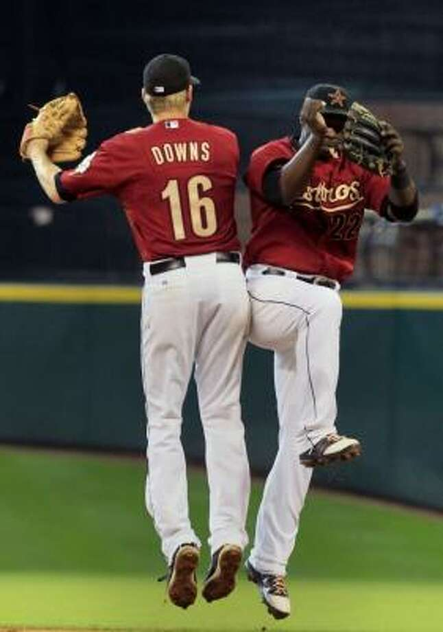 Astros infielders Matt Downs (16) and Bill Hall (22) celebrateafter defeating the Brewers. Photo: Cody Duty, Chronicle