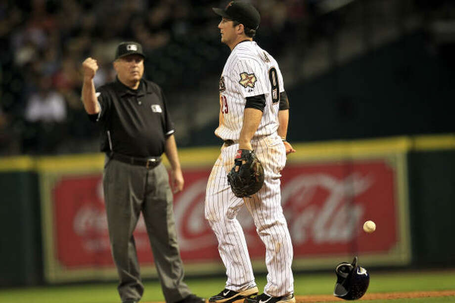 Umpire Derryl Cousins calls an out as Astros first baseman Brett Wallace stands up after being steam-rolled in a collision with Milwaukee's Prince Fielder during the seventh inning. Photo: Michael Paulsen, Chronicle