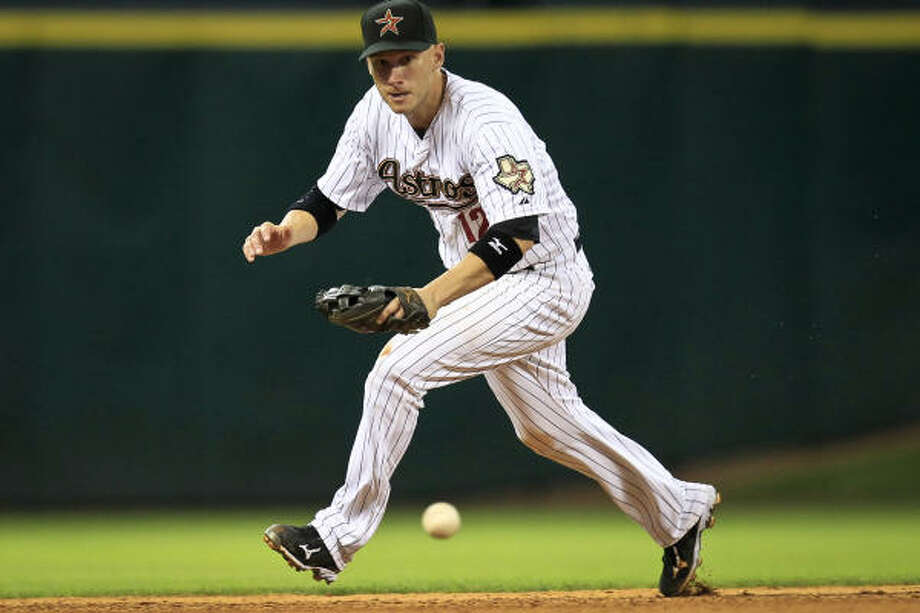 Astros shortstop Clint Barmes fields a grounder. Photo: Michael Paulsen, Chronicle