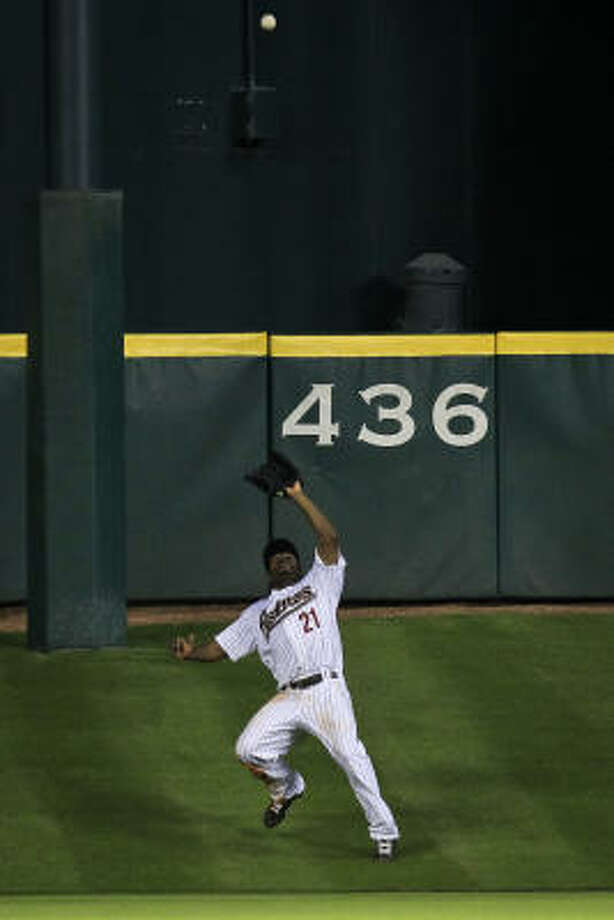 Astros center fielder Michael Bourn catches a pop fly by Corey Hart for the second out of the seventh inning. Photo: Michael Paulsen, Chronicle