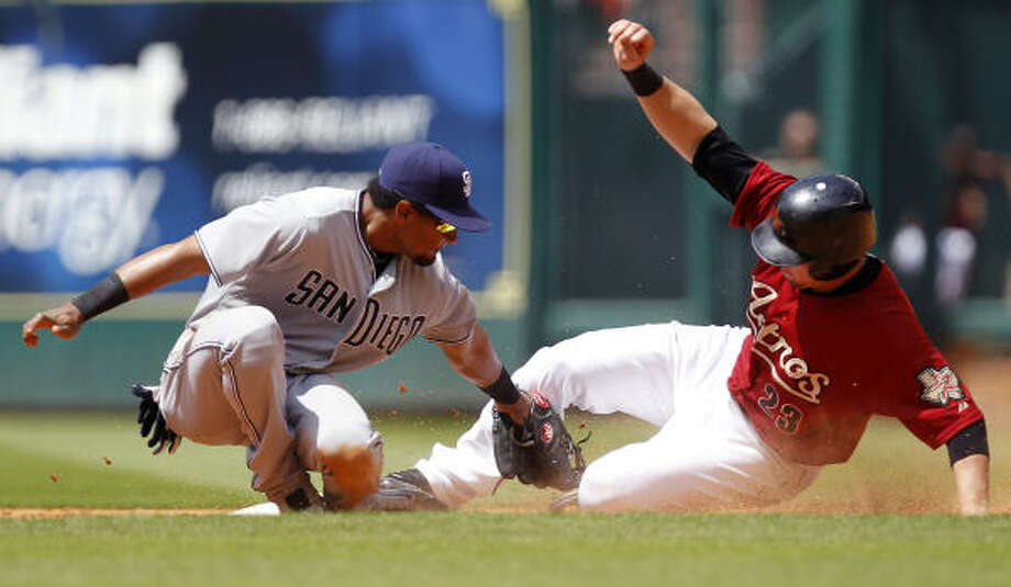 April 17: Padres 8, Astros 6Astros third baseman Chris Johnson slides into second as Padres second baseman Eric Patterson tags him out in the sixth inning. Photo: Cody Duty, Chronicle