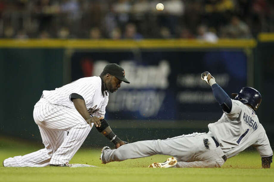 April 14: Astros 1, Padres 0Astros second baseman Bill Hall, left, bobbles the ball and can't cut off a steal by San Diego's Orlando Hudson during the sixth inning of Thursday's game at Minute Maid Park. Photo: Michael Paulsen, Chronicle