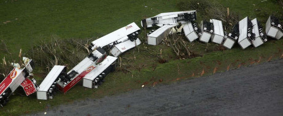 This aerial photograph shows trailers strewn on the ground at Utility Trailer Manufacturing Co in Glade Spring, Va. following an early morning tornado Wednesday  on Thursday April 28, 2011.  An official estimate of the damage which spread from southwestern to northeastern Virginia _ was not available Thursday, but there was enough for Gov. Bob McDonnell to declare a state of emergency. The declaration allows state resources to be used in local recovery efforts. Photo: Eric Brady, AP