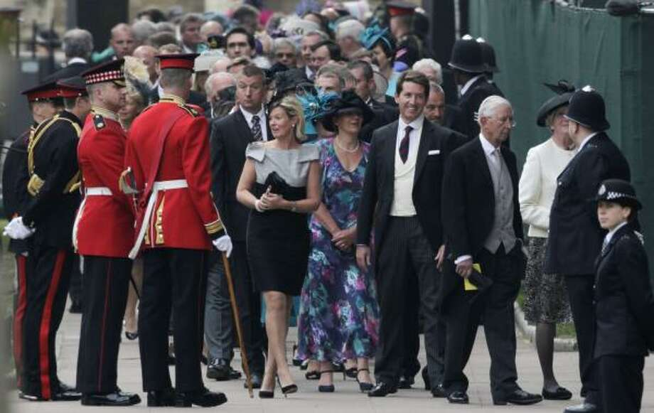People wait to enter Westminster Abbey prior to the Royal Wedding. Photo: Gero Breloer, AP