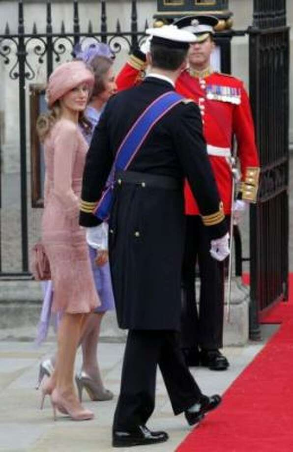 Princess Letizia of Asturias looks on with Queen Sofia of Spain and Prince Felipe of Asturias as they arrive to attend the Royal Wedding.