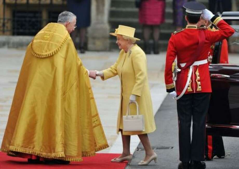 Queen Elizabeth II and Prince Philip, Duke of Edinburgh are greeted by The Right Reverend Dr John Hall, Dean of Westminster.