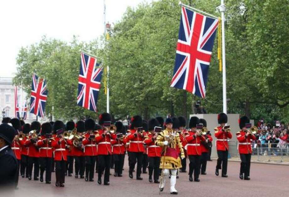 Ceremonial guards perform along the Mall ahead of the Royal Wedding.
