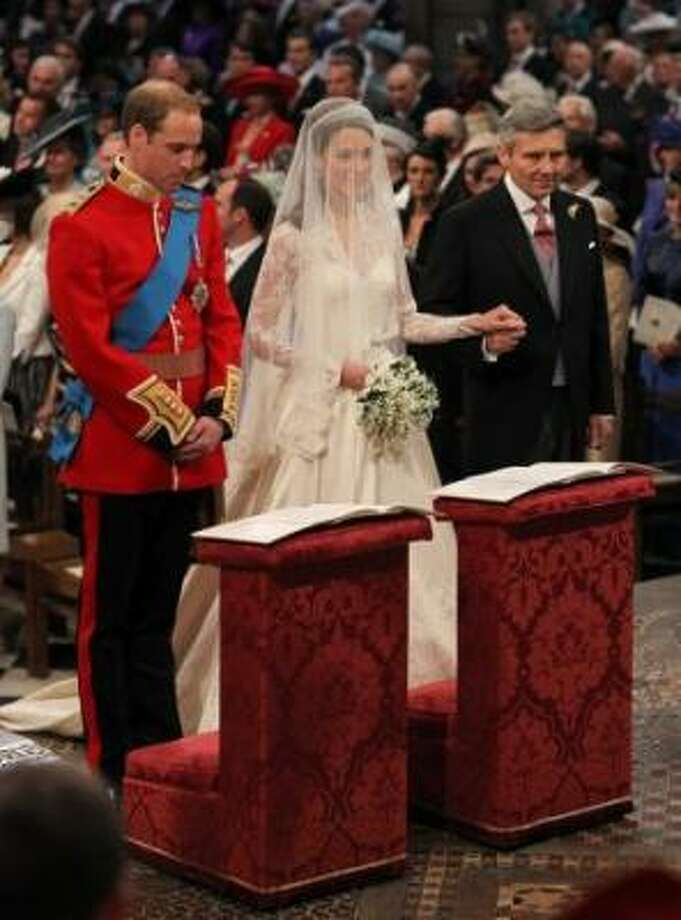 Prince William and Kate Middleton stand at the altar with Kate's father Michael Middleton.