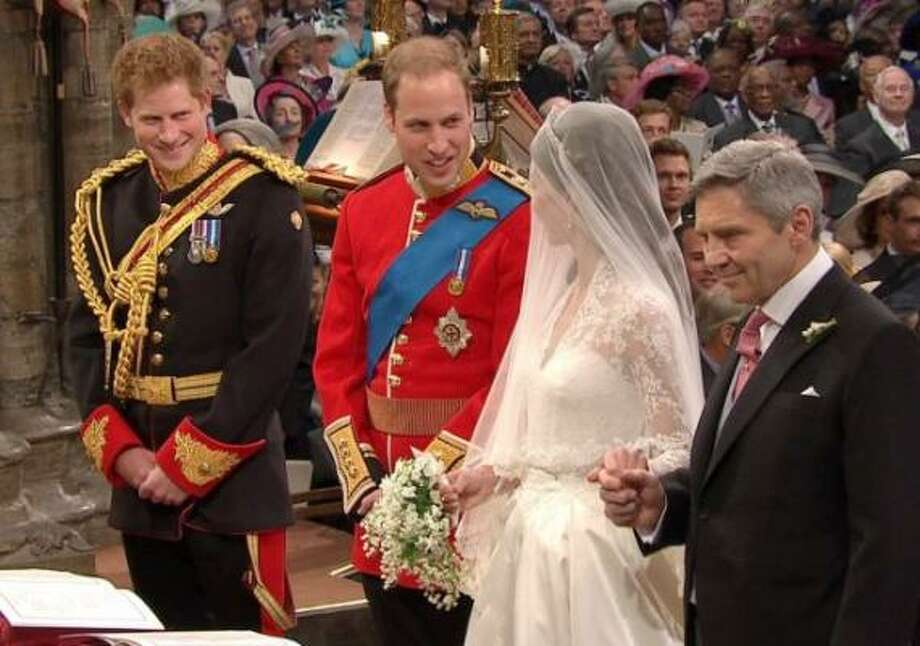 Britain's Prince William, second left, looks at his bride, Kate Middleton, as they stand at the altar.