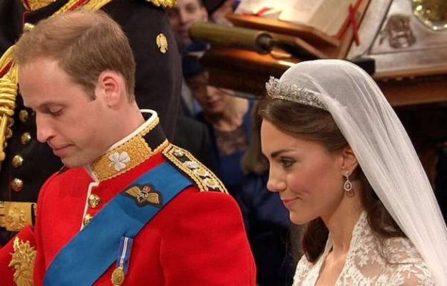 Britain's Prince William, left, stands at the altar with his wife, Kate, the Duchess of Cambridge.