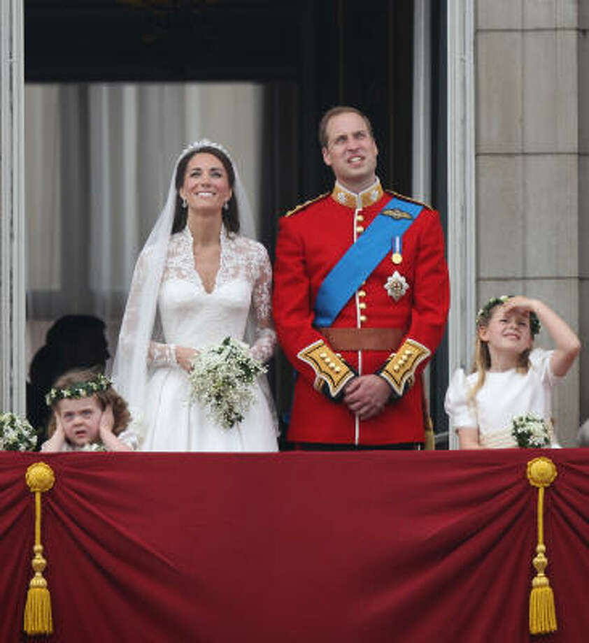Prince William, Duke of Cambridge, Catherine, Duchess of Cambridge and Bridesmaids Grace Van Cutsem and Margarita Armstrong-Jones greet well-wishers from the balcony at Buckingham Palace. Photo: Peter Macdiarmid, Getty Images
