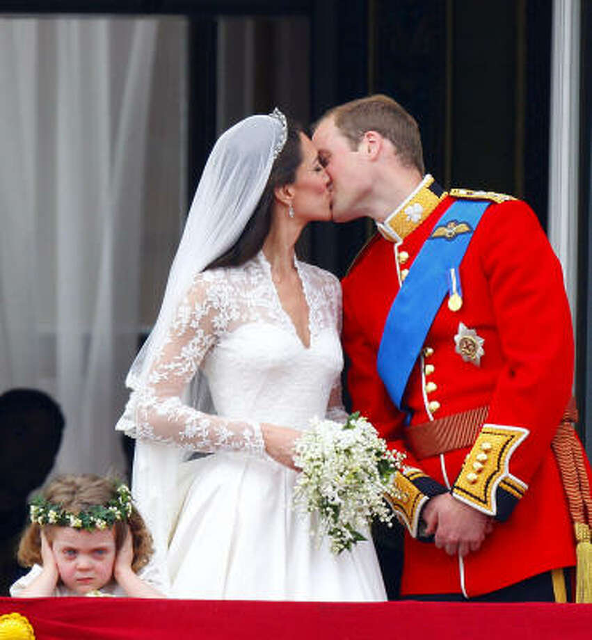 Bridesmaid Grace van Cutsem appears disinterested as Prince William and his wife, Kate, Duchess of Cambridge, kiss on the balcony. Photo: Chris Ison, AP
